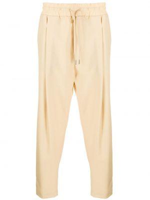 Beżowe spodnie wełniane zapinane na guziki Drole De Monsieur