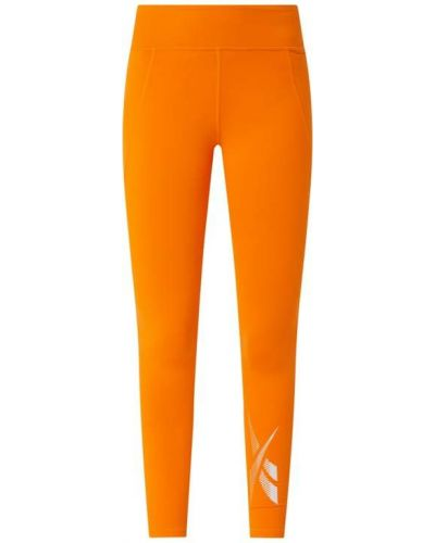 Pomarańczowe legginsy Reebok Active