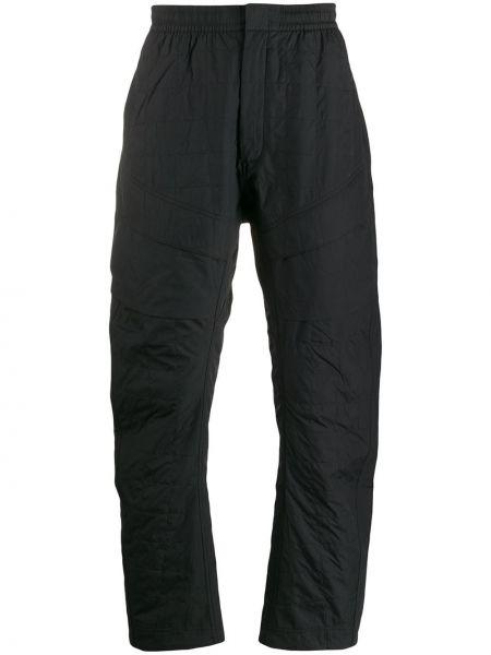 Свободные черные стеганые спортивные брюки Nike