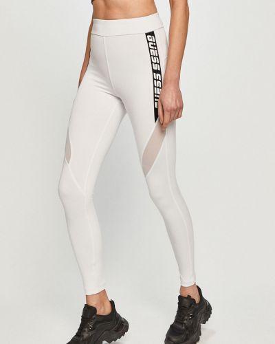 Białe legginsy dzianinowe z printem Guess