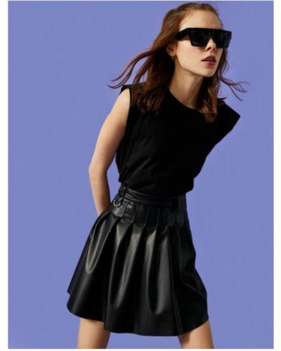 Czarna spódnica plisowana skórzana Koton
