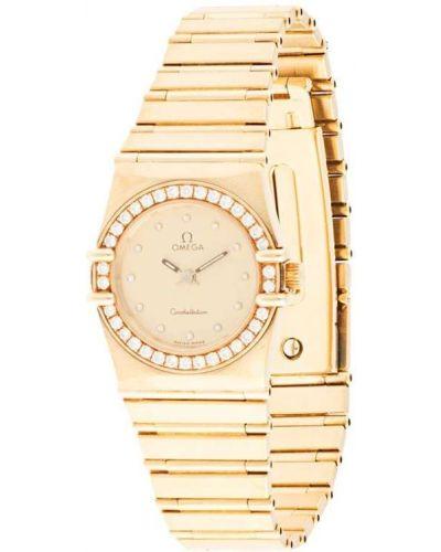 Кварцевые часы золотые с бриллиантом круглые Omega