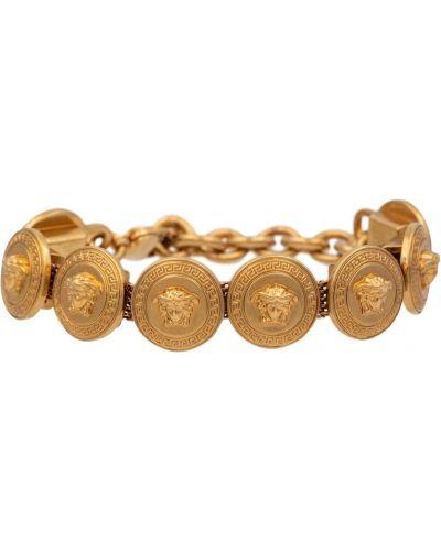 Żółta złota bransoletka ze złota z paskiem Versace
