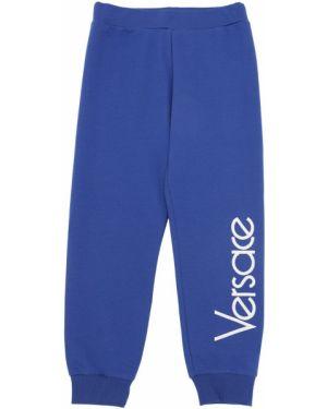 Spodnie na gumce z kieszeniami z logo Versace