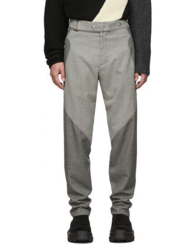 Czarne spodnie wełniane z paskiem Kiko Kostadinov