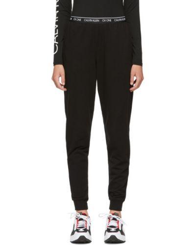 Хлопковые черные брюки дудочки стрейч Calvin Klein Underwear
