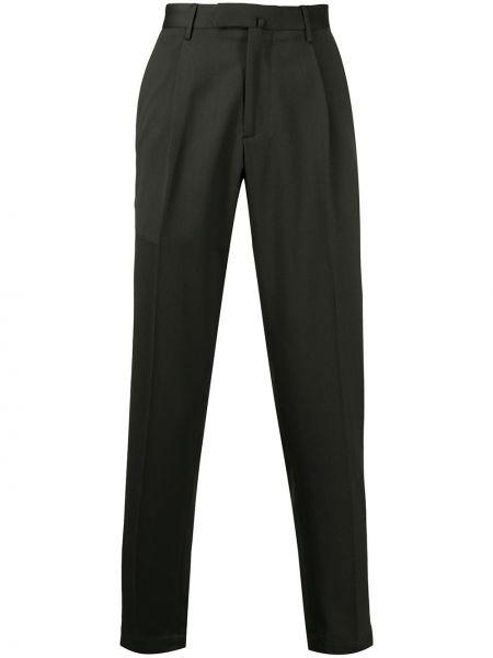 Зеленые шерстяные облегающие деловые зауженные брюки Dell'oglio