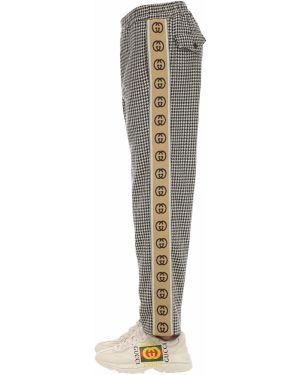 Beżowe joggery wełniane z printem Gucci