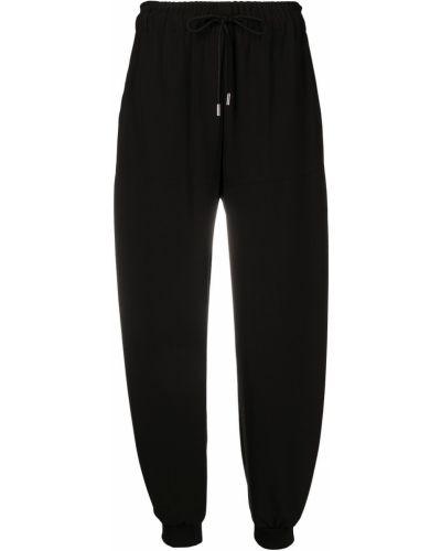 Шелковые черные брюки с карманами Chloé