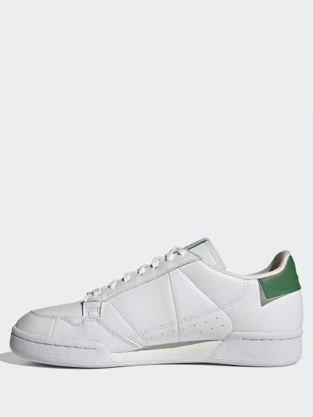 Белые низкие кеды Adidas
