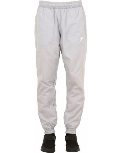 Спортивные брюки с карманами на резинке Nike