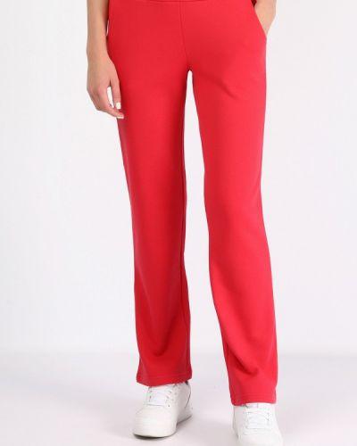 Красные спортивные брюки Montana