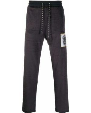 Черные прямые брюки пэчворк с заплатками с карманами Roberto Cavalli