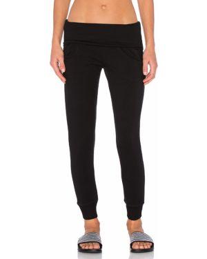 Spodnie na gumce z fałdami elastyczne Beyond Yoga