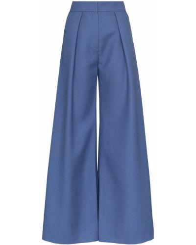 Костюмные расклешенные свободные брюки с карманами Vika Gazinskaya