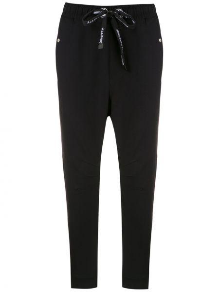 Черные брюки с карманами узкого кроя из вискозы à La Garçonne