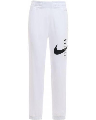 Biały joggery z kieszeniami Nike