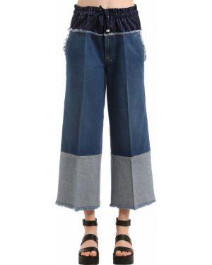 Niebieskie jeansy rozkloszowane boho Sonia Rykiel