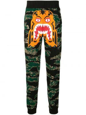Спортивные зауженные брюки с карманами с манжетами бязевые Bape