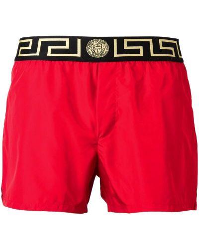 Красные шорты Versace