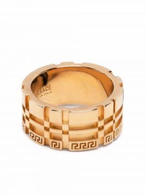 Кольцо металлическое золотое Versace