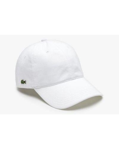 Biała czapka z daszkiem bawełniana z haftem Lacoste