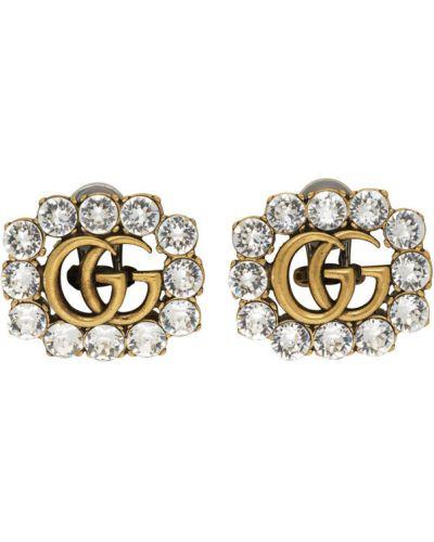 Серьги-гвоздики золотые прозрачные Gucci
