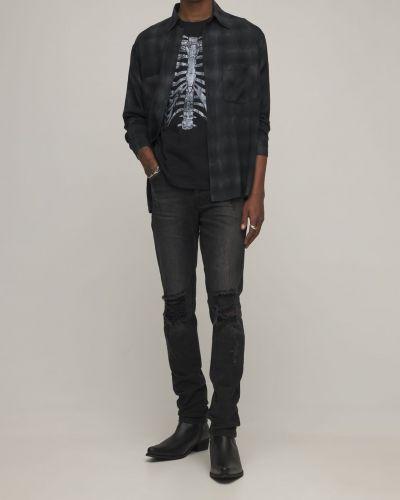 Czarne jeansy rurki Other