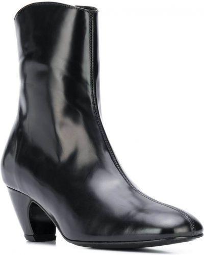Кожаные черные ботильоны на каблуке на молнии Dorateymur