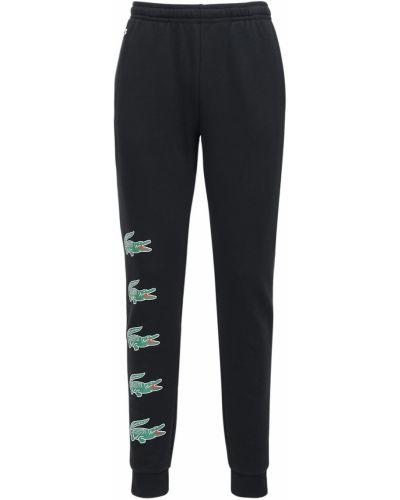 Czarne joggery z haftem bawełniane Lacoste