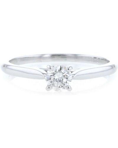С ромбами белое кольцо с бриллиантом Cartier
