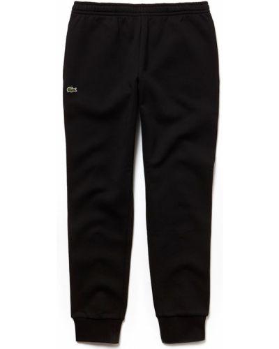 Czarne joggery bawełniane Lacoste