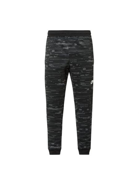 Spodni czarny spodnie na gumce z kieszeniami z zamkiem błyskawicznym Nike