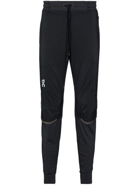 Спортивные брюки - черные On Running