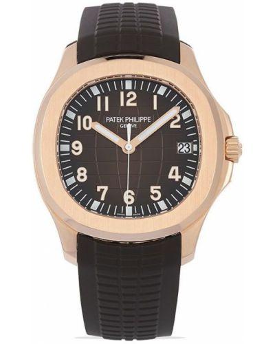 Коричневые с ремешком часы круглые Patek Philippe