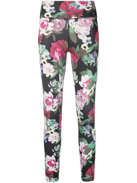 Czarne legginsy z printem w kwiaty Nike