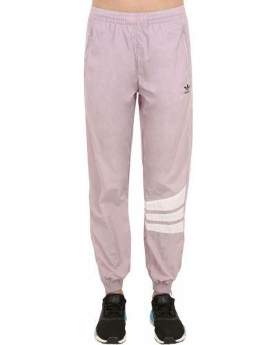 Спортивные брюки на кнопках - фиолетовые Adidas Originals