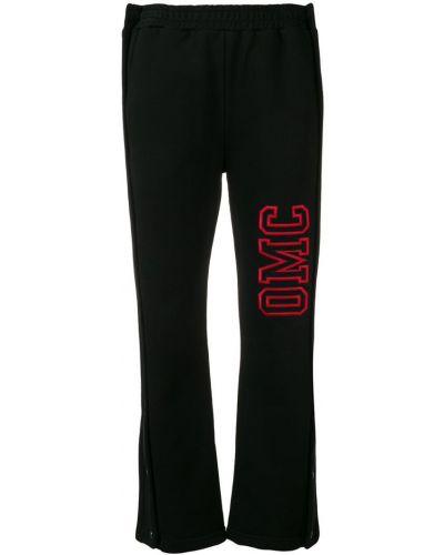 Черные джоггеры с вышивкой Omc