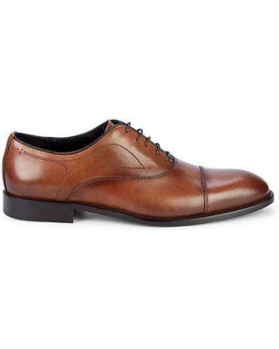 Кружевные кожаные оксфорды на каблуке Bruno Magli