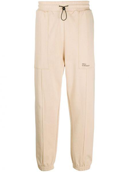 Beżowe spodnie bawełniane z printem Drole De Monsieur