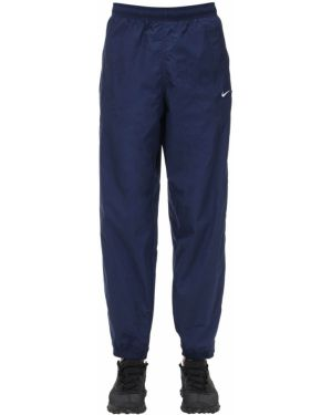 С кулиской синие спортивные брюки с карманами с вышивкой Nike