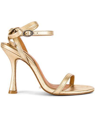 Złote sandały klamry kopertowe Jaggar