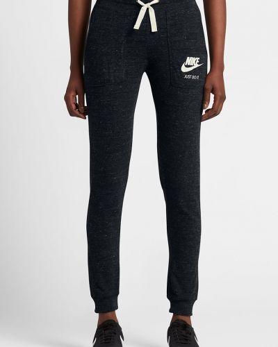Брюки на резинке прямые с карманами Nike