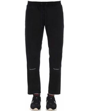 Черные брюки на резинке с заплатками с карманами United Standard