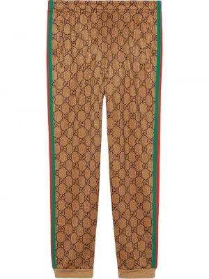 Zielone spodnie bawełniane z printem Gucci