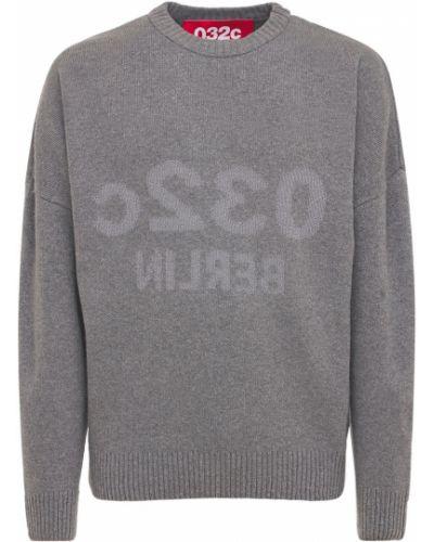 Sweter wełniany z printem 032c