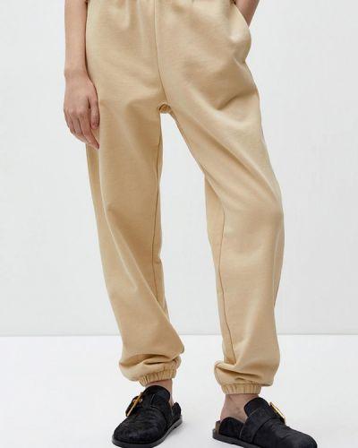 Бежевые брюки Lime