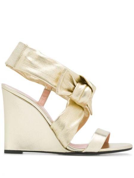 Złote sandały na platformie Pollini