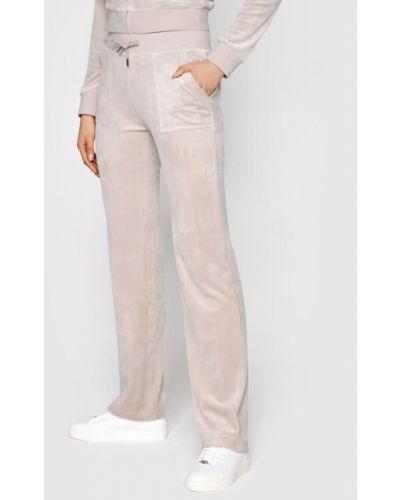 Różowe spodnie dresowe Juicy Couture