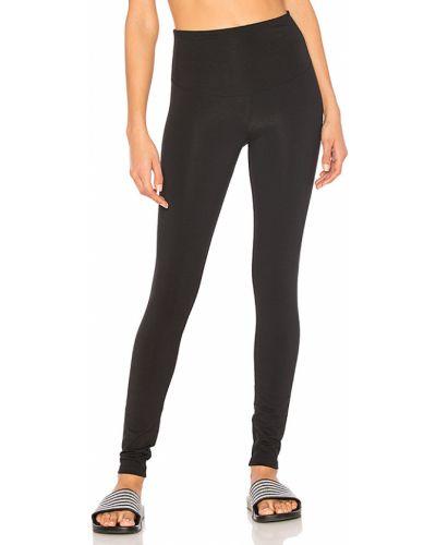 Czarne legginsy do biegania bawełniane Yummie